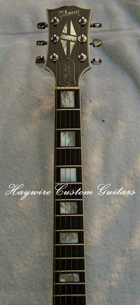 image from Haywire Custom Guitars service center of a Gibson custom Les Paul with broken headstock